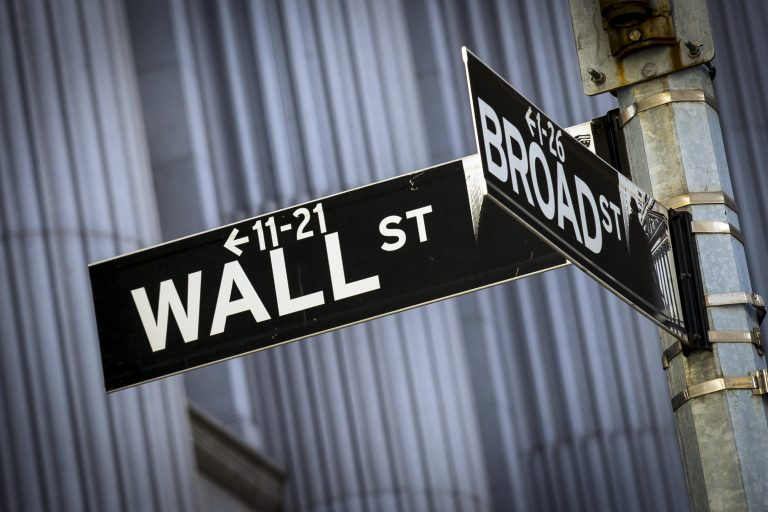 Street signs for Wall St. and Broad St. hang at the corner outside the New York Stock Exchange March 24, 2015. REUTERS/Brendan McDermid